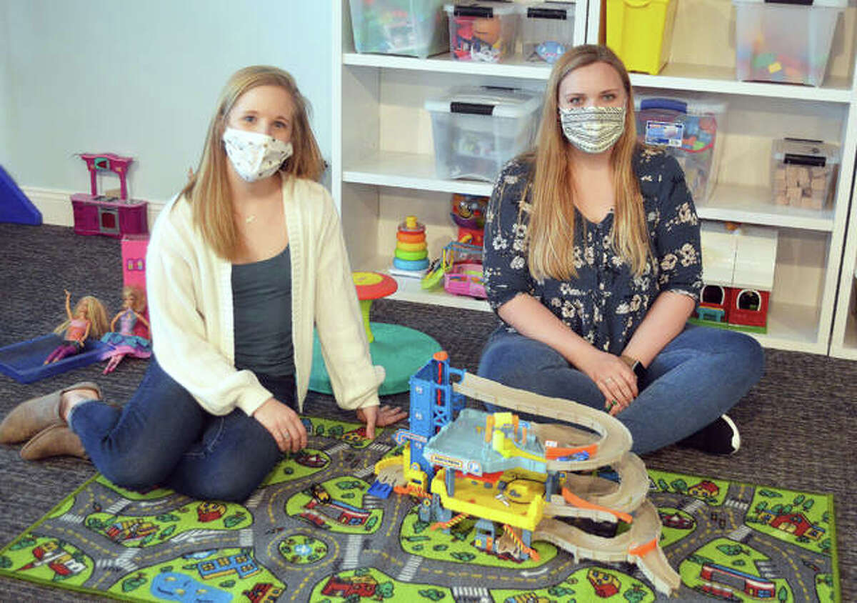 Lead Clinician Meredith Becks, left, and Clinic Manager Kaitlynne McNutt with some of the toys used by their young clients at Behavioral Perspective, Inc., in Glen Carbon.