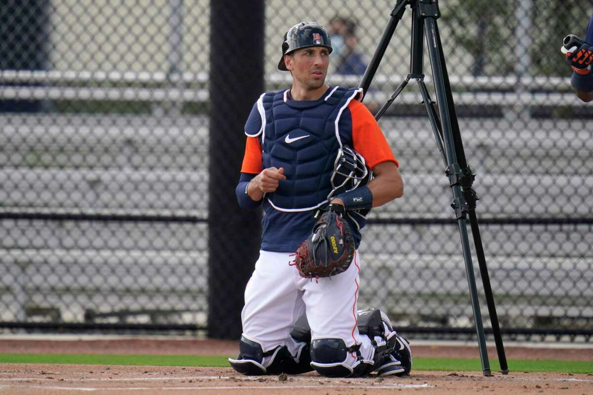 Houston Astros catcher Jason Castro takes up his position during spring training baseball practice Wednesday, Feb. 24, 2021, in West Palm Beach, Fla. (AP Photo/Jeff Roberson)