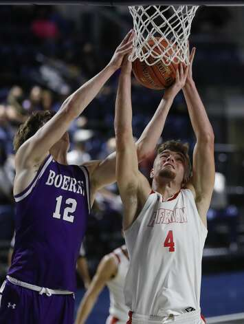 Huffman's Luke Thomas (4) grabs a rebound against Boerne's Luke Whidbee (12) during the second quarter of a Class 4A state semifinal game at Delmar Fieldhouse, Tuesday, March 9, 2021, in Houston. Photo: Jason Fochtman/Staff Photographer / 2021 © Houston Chronicle