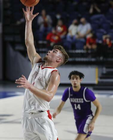 Huffman's Luke Thomas (4) tries to grab a rebound during the first quarter of a Class 4A state semifinal game at Delmar Fieldhouse, Tuesday, March 9, 2021, in Houston. Photo: Jason Fochtman/Staff Photographer / 2021 © Houston Chronicle
