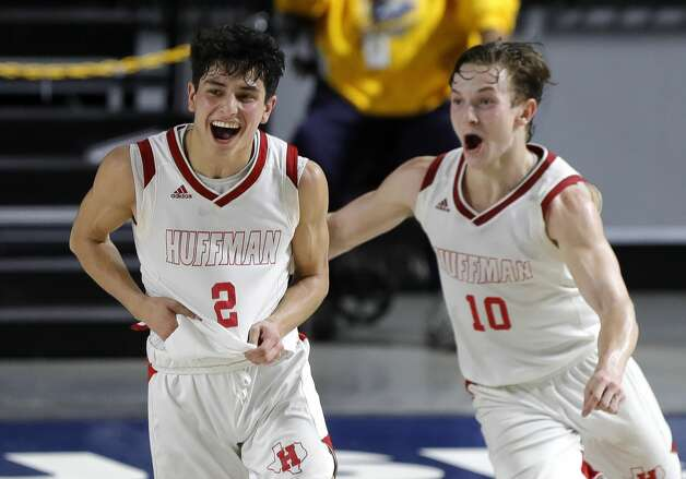 Huffman's Gabe Cardenas (2) and point guard Jacob Harvey (10) celebrate after defeating Boerne 55-49 during a Class 4A state semifinal game at Delmar Fieldhouse, Tuesday, March 9, 2021, in Houston. Photo: Jason Fochtman/Staff Photographer / 2021 © Houston Chronicle