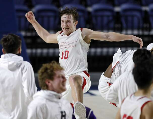 Huffman point guard Jacob Harvey (10) celebrates after defeating Boerne 55-49 during a Class 4A state semifinal game at Delmar Fieldhouse, Tuesday, March 9, 2021, in Houston. Photo: Jason Fochtman/Staff Photographer / 2021 ? Houston Chronicle