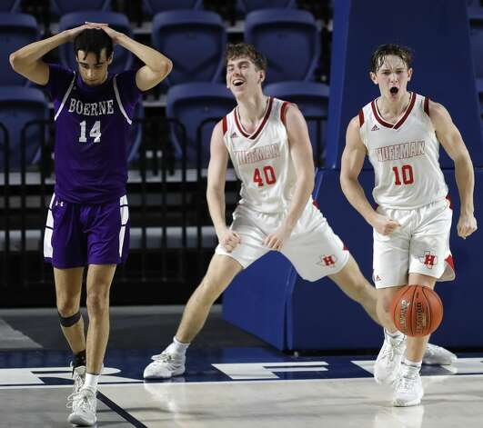 Huffman point guard Jacob Harvey (10) reacts beside teammate Grey Soileau (40) after drawing a charge against Boerne point guard Joaquin Gonzalez (14) during the fourth quarter of a Class 4A state semifinal game at Delmar Fieldhouse, Tuesday, March 9, 2021, in Houston. Huffman defeated Boerne 55-49. Photo: Jason Fochtman/Staff Photographer / 2021 ? Houston Chronicle
