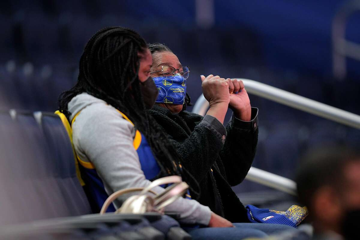 James Wiseman's mother Donzaleigh Artis, right, and sister, Jaquarius Greer, left, watch as James and the Golden State Warriors played the Minnesota Timberwolves at Chase Center in San Francisco, Calif., on Monday, January 25, 2021. Greer was attending her first NBA game and was visiting her mother, who moved to San Francisco to be closer to James