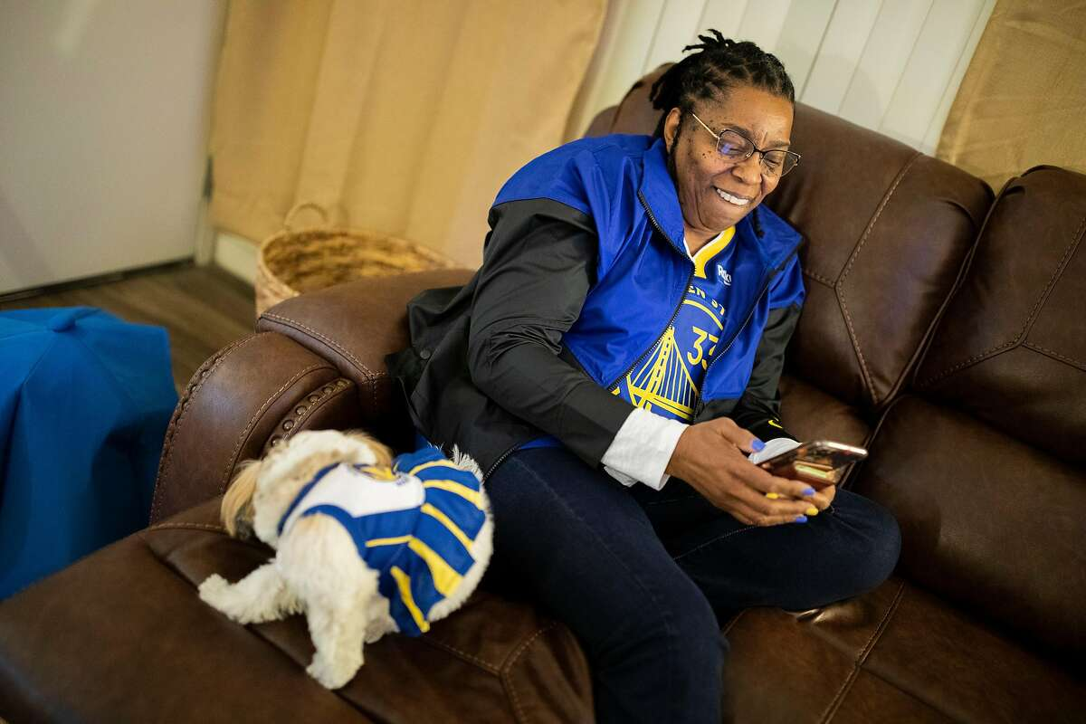 At her San Francisco apartment watching the NBA game with her dog Celerie, Donzaleigh Artis' phone continuously rings with new message alert from friends and family who are reacting to her son and Golden State Warriors center James Wiseman dunking against the Los Angeles Lakers in the first quarter on Monday, Jan. 18, 2021.