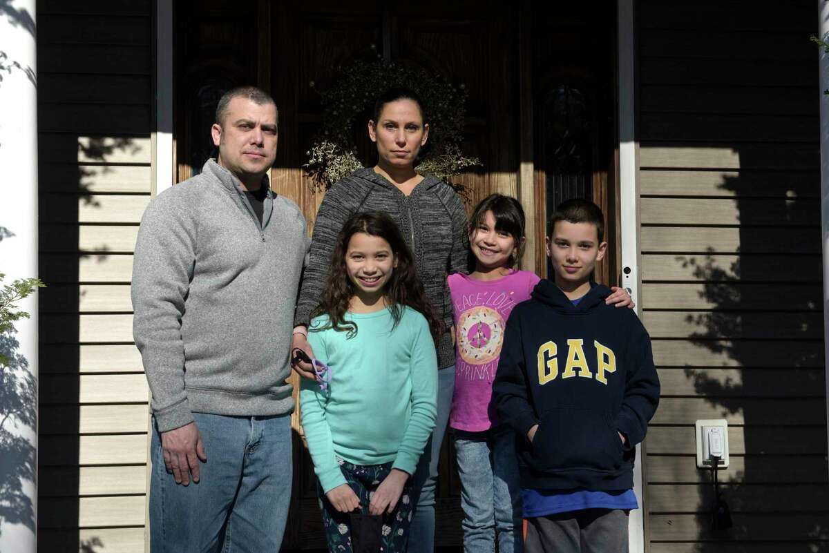 The Fung family, John and Rebecca with Aviva, 9, left; Adina, 6, and Aaron, 12, lost their dog Buddy, who was electrocuted by a downed power line after Tropical Storm Isaias.