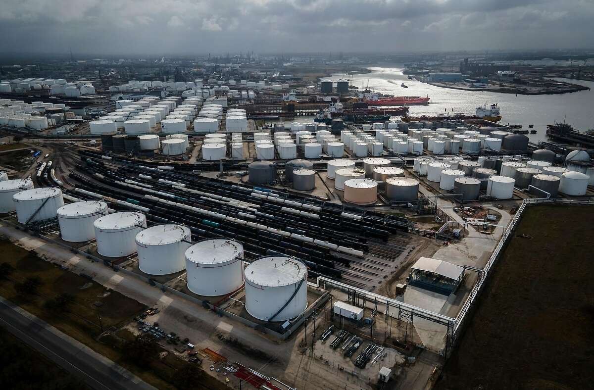Storage tanks fills the landscape along the Houston Ship Channel in Deer Park, Texas. The suits against the oil companies, filed in 2017, seek billions of dollars in damages from Chevron, BP, ConocoPhillips, ExxonMobil and Shell.