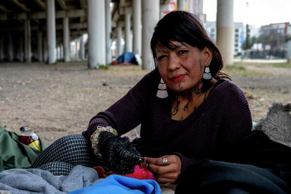 Maria Torres says she has been living on the streets for two years, most recently under the I-37 overpass. Torres lost all of her belongings when the city removed the camp and threw tents and belongings into dumpsters to be hauled away.