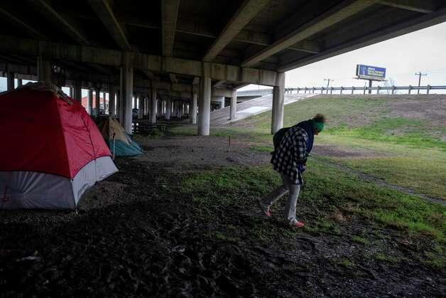 Desperate for warmth, Hester leaves the campsite under the I-37 overpass where she'd been living in hopes of finding boots to replace her thin sneakers. Photo: Jessica Phelps /San Antonio Express-News / **MANDATORY CREDIT FOR PHOTOG AND SAN ANTONIO EXPRESS-NEWS/NO SALES/MAGS OUT/TV  © 2021 San Antonio Express-News