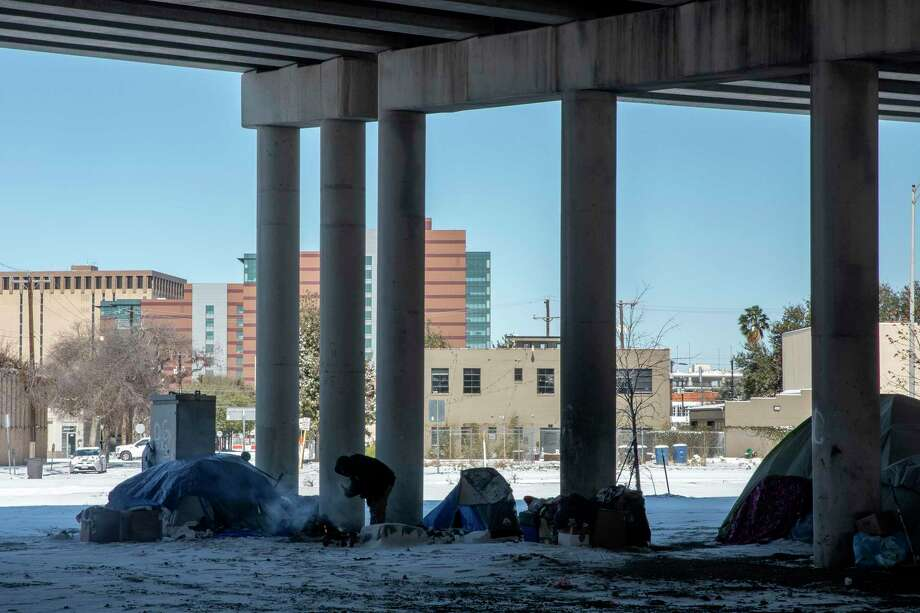 Many people experiencing homelessness decided to ride out February's record-shattering winter storm in their tents. They didn't trust the city or social service providers enough to go into emergency shelters, even for a few days. Photo: Jessica Phelps /San Antonio Express-News / **MANDATORY CREDIT FOR PHOTOG AND SAN ANTONIO EXPRESS-NEWS/NO SALES/MAGS OUT/TV  © 2021 San Antonio Express-News