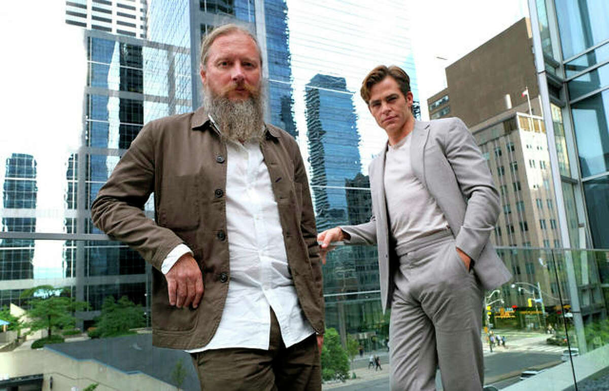"""In this Sept. 7, 2018 photo, David Mackenzie, left, director of the film """"Outlaw King,"""" and actor Chris Pine pose during the Toronto Film Festival at the Shangri-La Hotel in Toronto."""