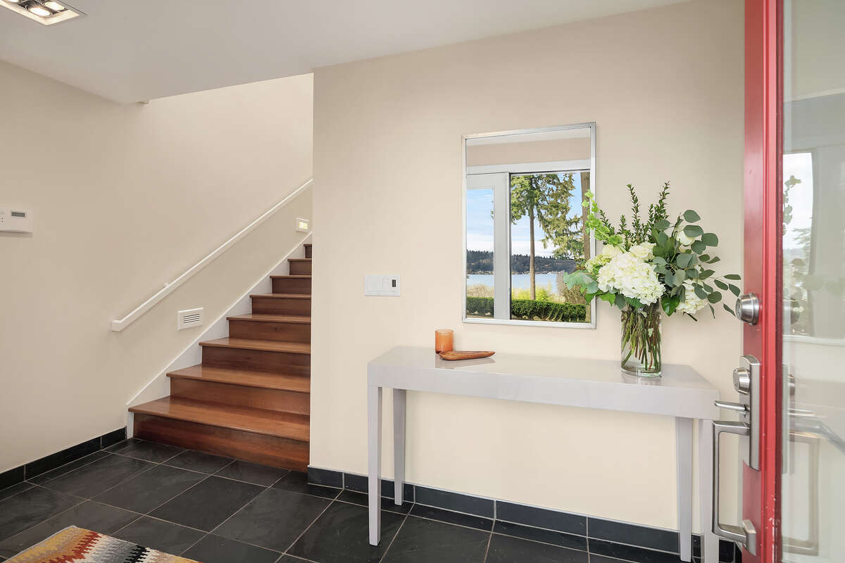 From the entry, we ascend to the main living level.
