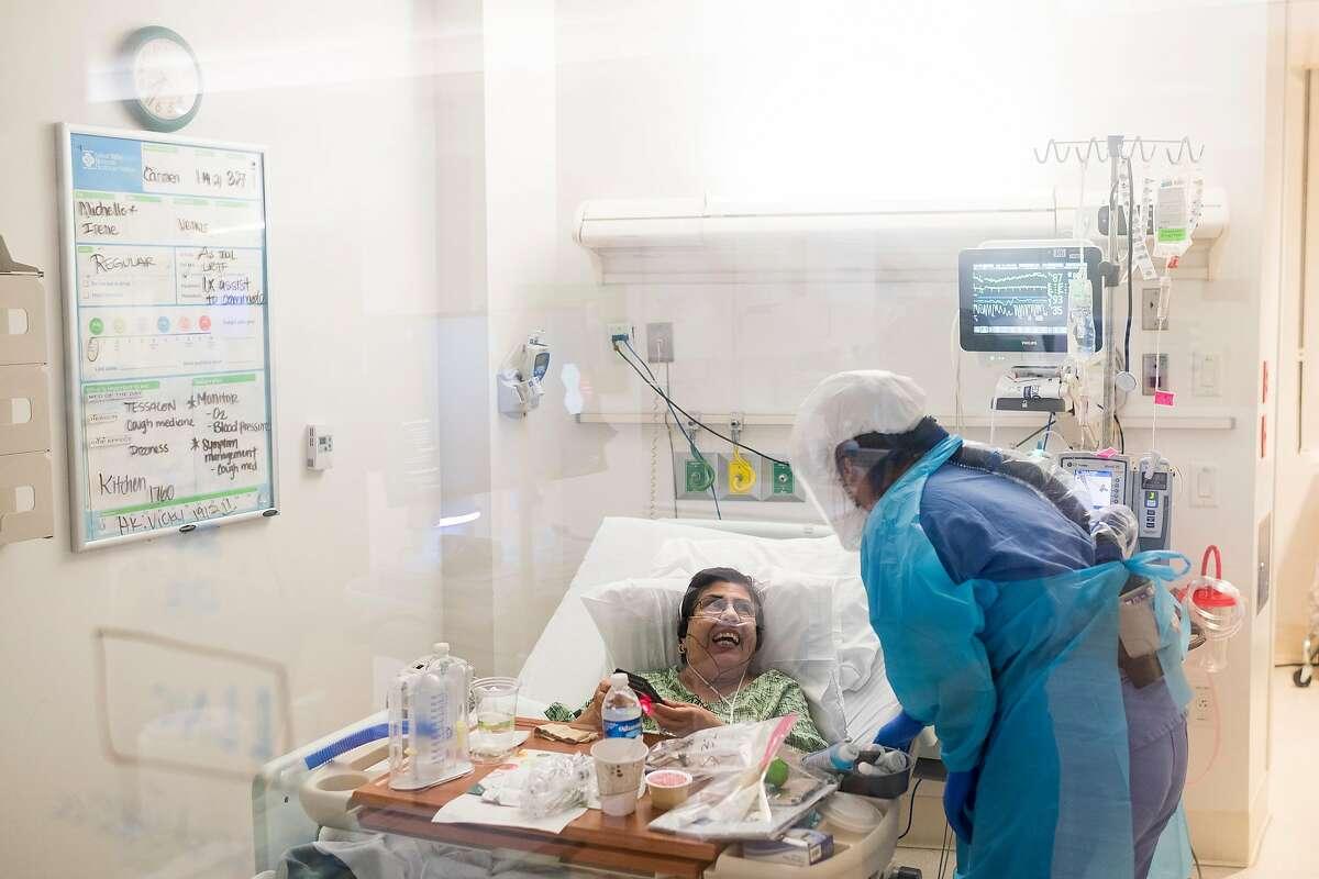 Nurse Cassie Barber tends to Carmelita Martinez at Salinas Valley Memorial Hospital.
