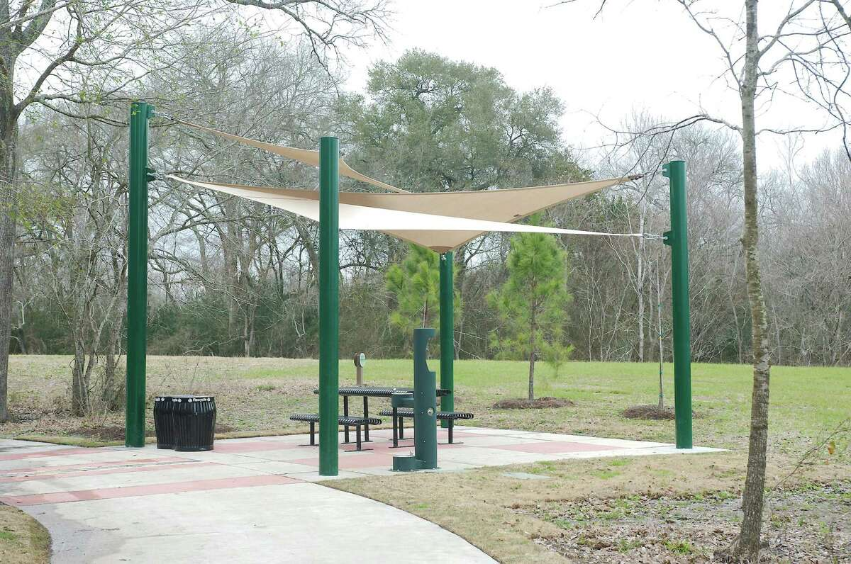 Trailside structures along the Shadow Creek trail provide shading resting spots for those walking or cycling the path.