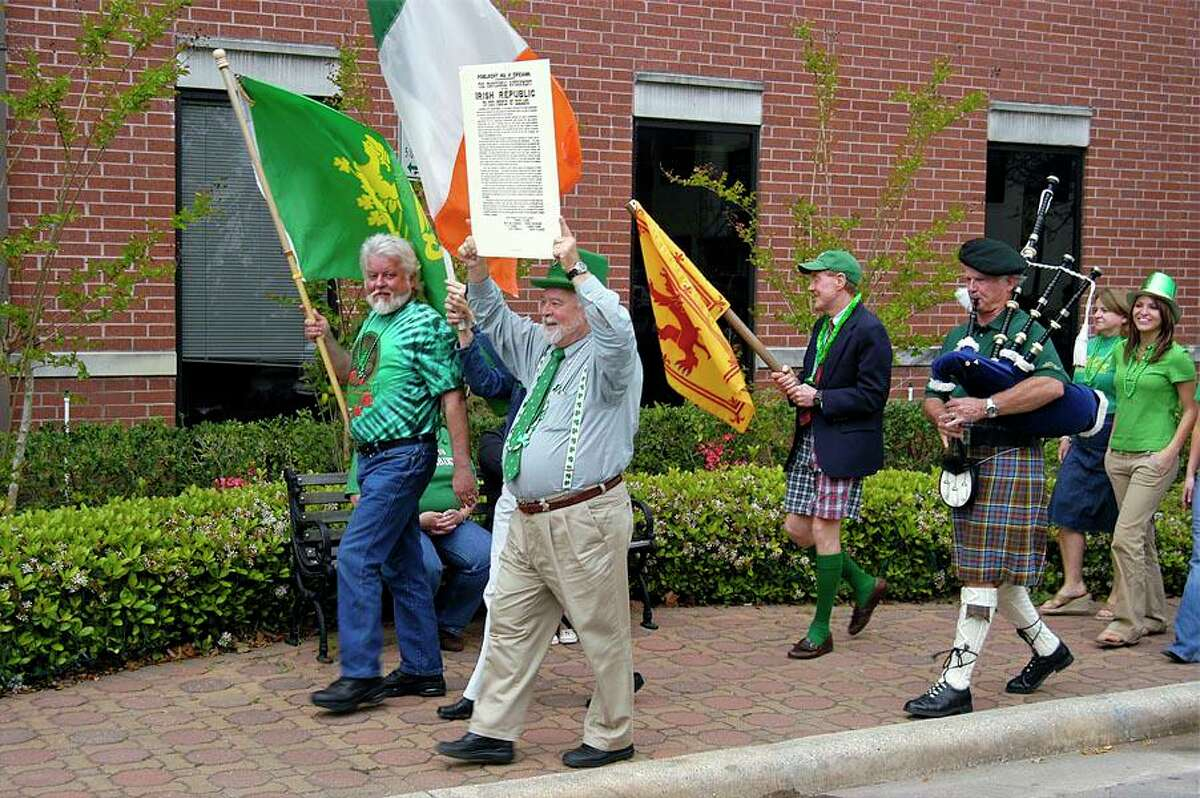 """From left are """"Fitz"""" Fitzpatrick, Pat Green holding up the Irish Proclamation,Mike McDougal andbagpiper David Anderson. The """"Pat Green and David Anderson Memorial St Patrick's Day Parade,"""" is set for 5 p.m. Wednesday at The Corner Pub in downtown Conroe."""