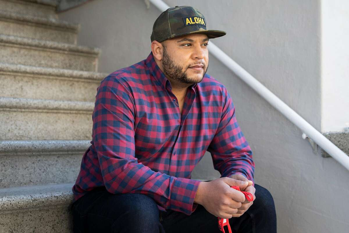 Matt Ruffin, one of the many people who have had a hard time getting his unemployment benefits, sits outside of his home in the Richmond District of San Francisco.