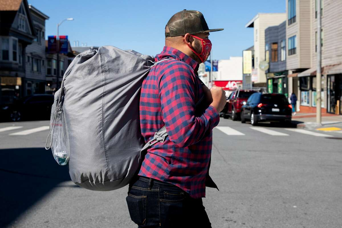 Matt Ruffin heads from his home in San Francisco's Richmond District to do his laundry.