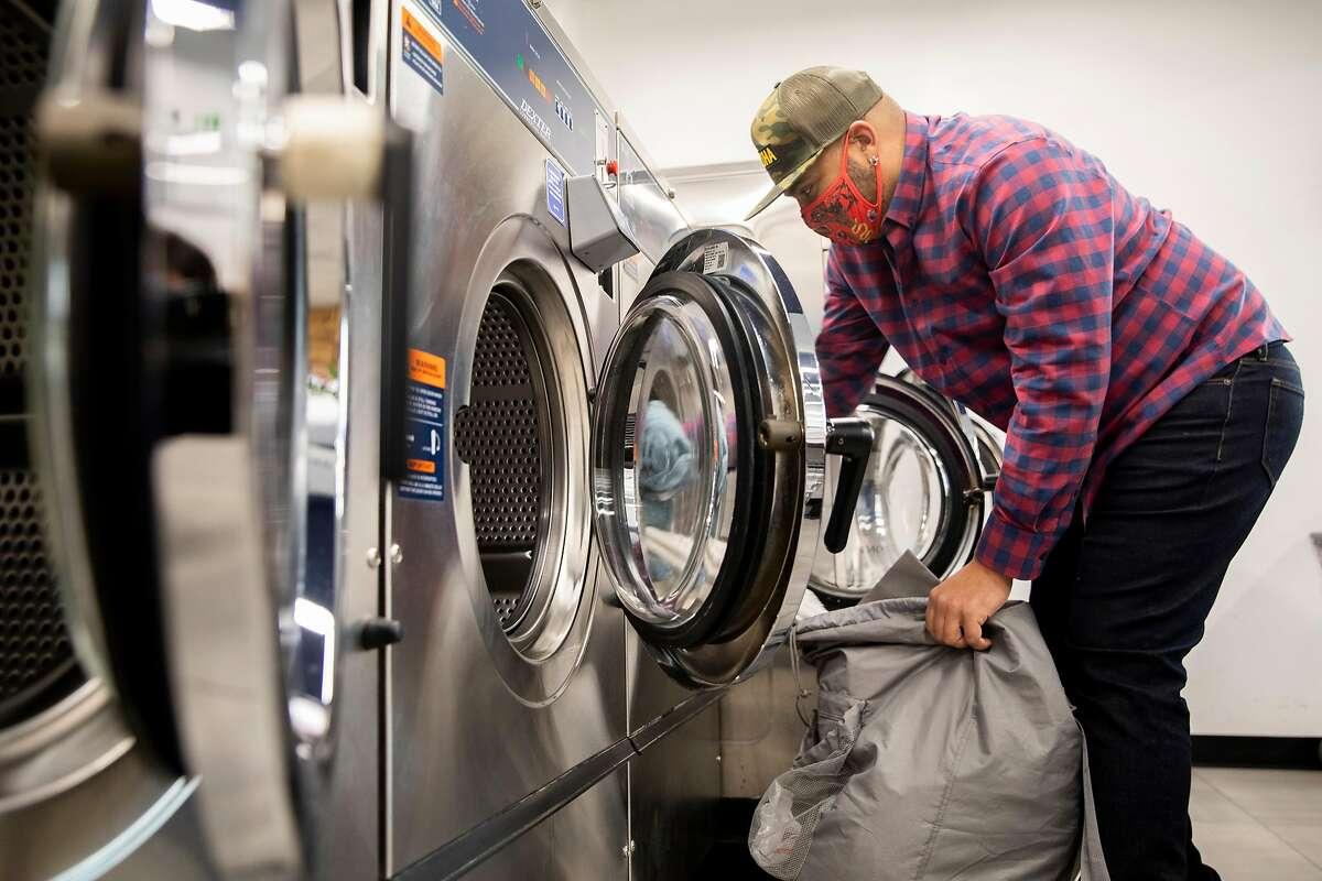 Matt Ruffin does his laundry near his home in San Francisco's Richmond District.