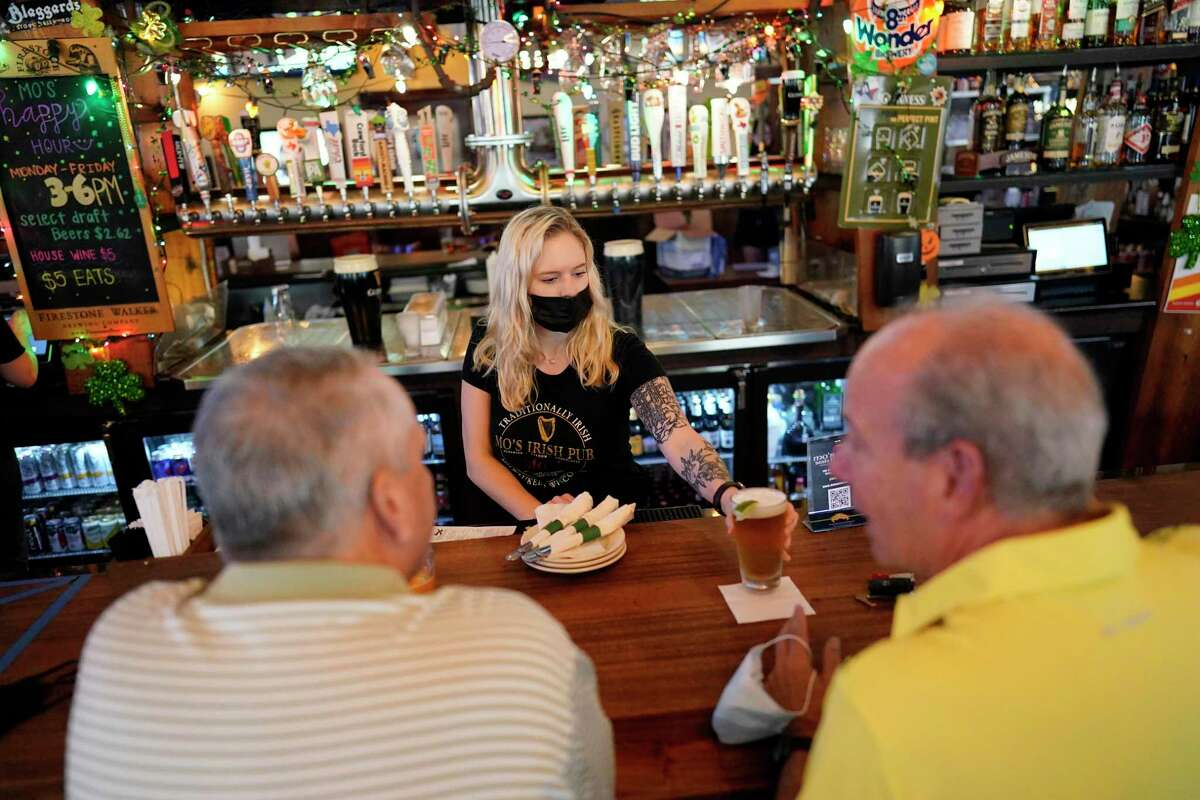 Patrons at a Houston pub last week forgo face masks. Readers react to Gov. Greg Abbott's controversial reversal of COVID-19 restrictions.