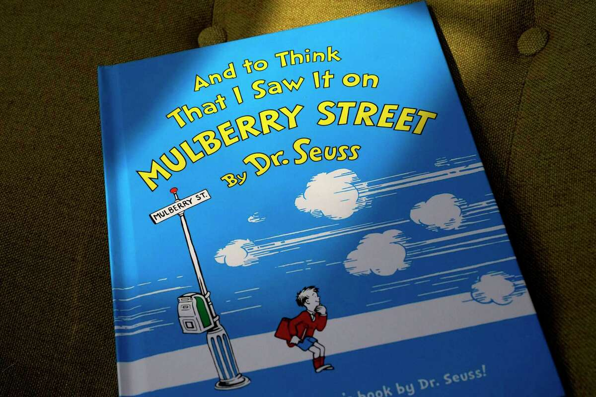 """A copy of the book """"And to Think That I Saw It on Mulberry Street,"""" by Dr. Seuss. The book and others will no longer be published due to racist imagery."""