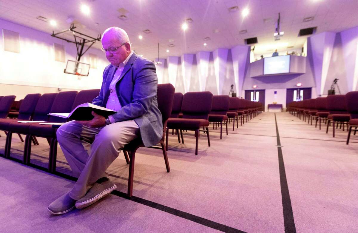 Senior Pastor Jay Gross looks over his sermon before streaming a worship service at West Conroe Baptist Church on March 15, 2020, in Conroe. The church, like many in the region, closed in-house services for parishioners after a disaster declaration was issued for Montgomery County, limiting public gatherings of 250 people or more because of the coronavirus. Many churches opted to stream services online for the safety of parishioners. When Gov. Greg Abbott lifted statewide COVID-19 restrictions Wednesday, businesses and other establishments were able to open at full capacity. Now churches also are having to decide if they will continue with mask mandates and limited capacity.
