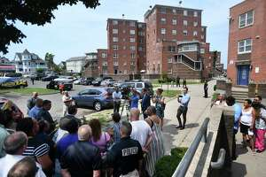 Bridgeport city officials hold a press conference at the Charles F. Greene Homes low income housing complex in Bridgeport, Conn. on Thursday, July 11, 2019. The city wants the troubled complex torn down.