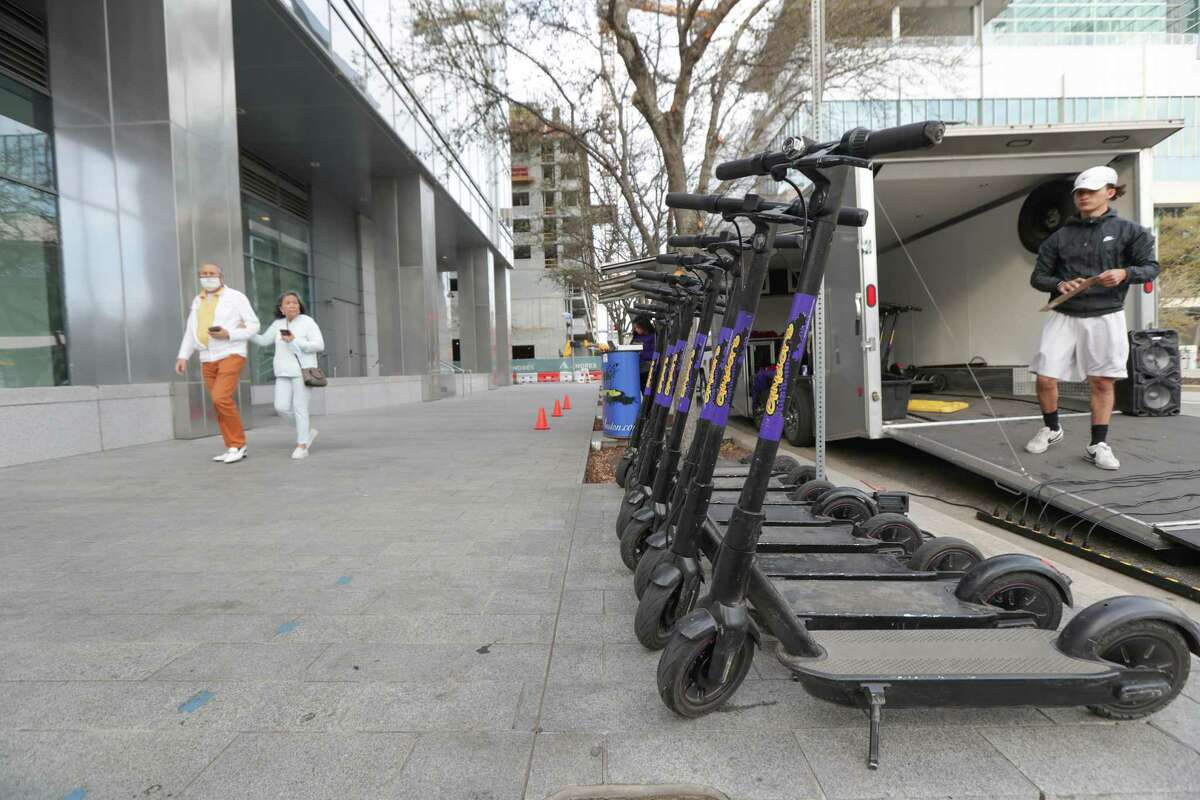 One of the city's complaints is the street scooters are blocking the sidewalks, which is not the case at Glyderz Houston's popup location on Crawford, steps from Discovery Green, on March 9, 2021, in Houston.