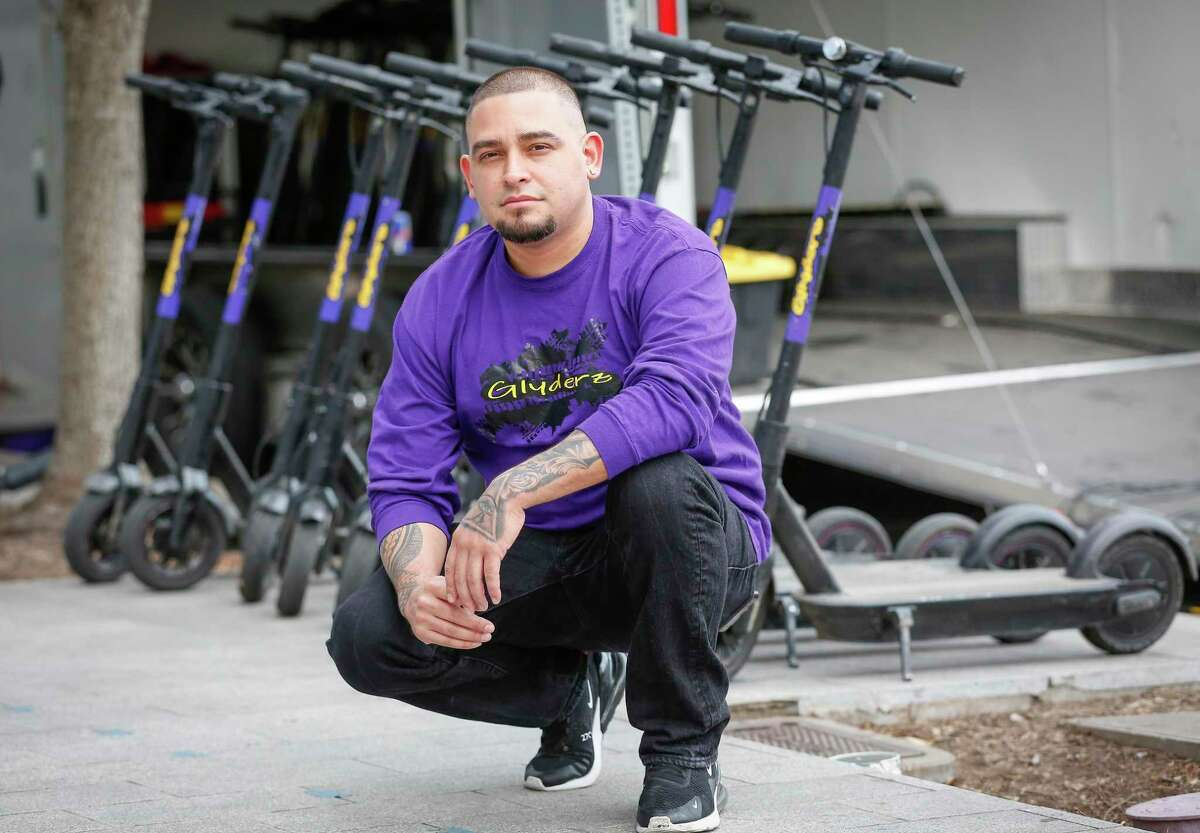 Juan Valentine, owner of Glyderz Houston, poses in front of his popup scooter rental business on March 9, 2021, in Houston. City officials on March 24 banned rental of scooters along public sidewalks.