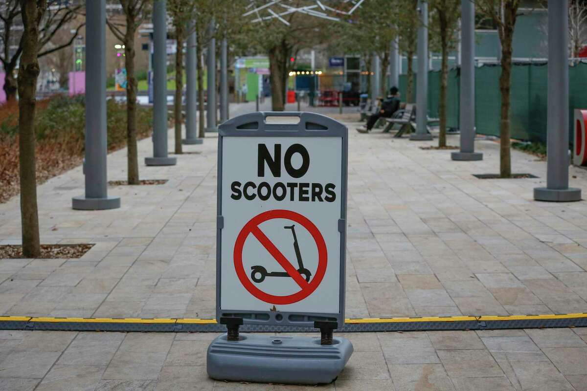 A no scooter sign warns riders to stay out of Discovery Green on March 9, 2021, in Houston. Officials, citing safety, restrict riding in the park.