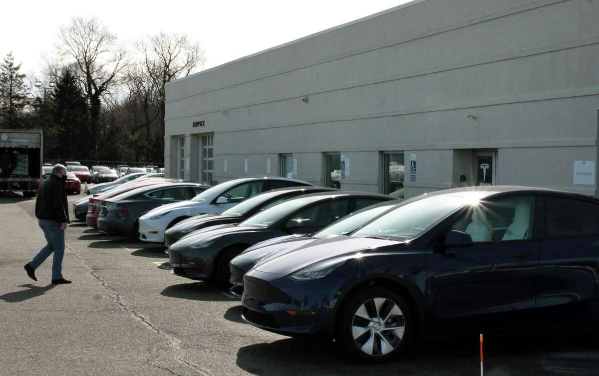 Exterior view of Tesla center along Boston Post Road in Milford, Conn., on Wednesday Feb. 17, 2021.