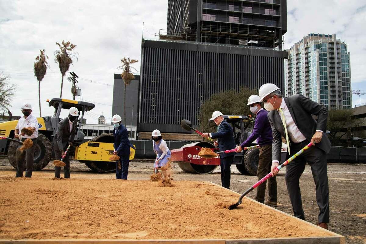 Members of the Downtown Redevelopment Authority, Mayor Sylvester Turner, Councilmember Robert Gallegos, Harris County Commissioner Rodney Ellis and other officials shovel dirt at a groundbreaking ceremony for Trebly Park in south downtown Houston Friday, March 12, 2021.