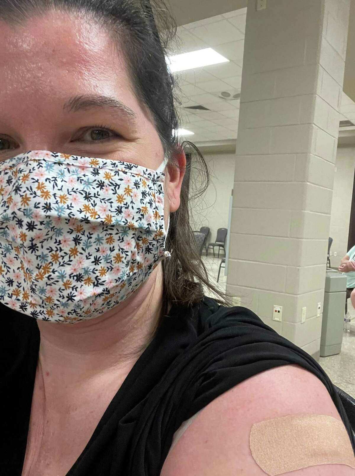 Keri Brown, a 42-year-old Houstonian, received her COVID-19 vaccine in Orange, Texas. She said the hardest part was taking off the Band-Aid.