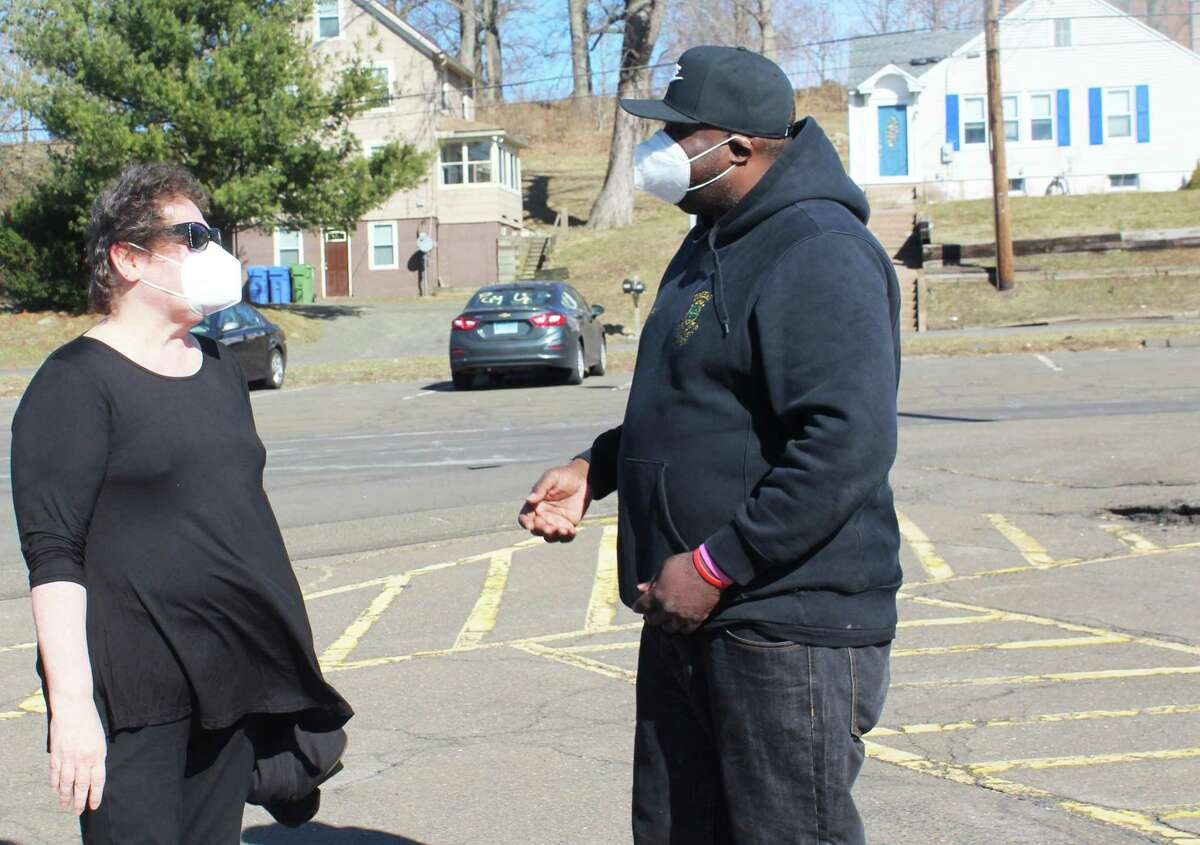 Connecticut Valley Hospital employees rallied Friday afternoon outside the Middletown campus to bring attention issues. Here, nurse supervisor Kim Michalsky, left, and Local 1199 union delegate Stephan Bobb, right, talk in the nearby commuter lot.