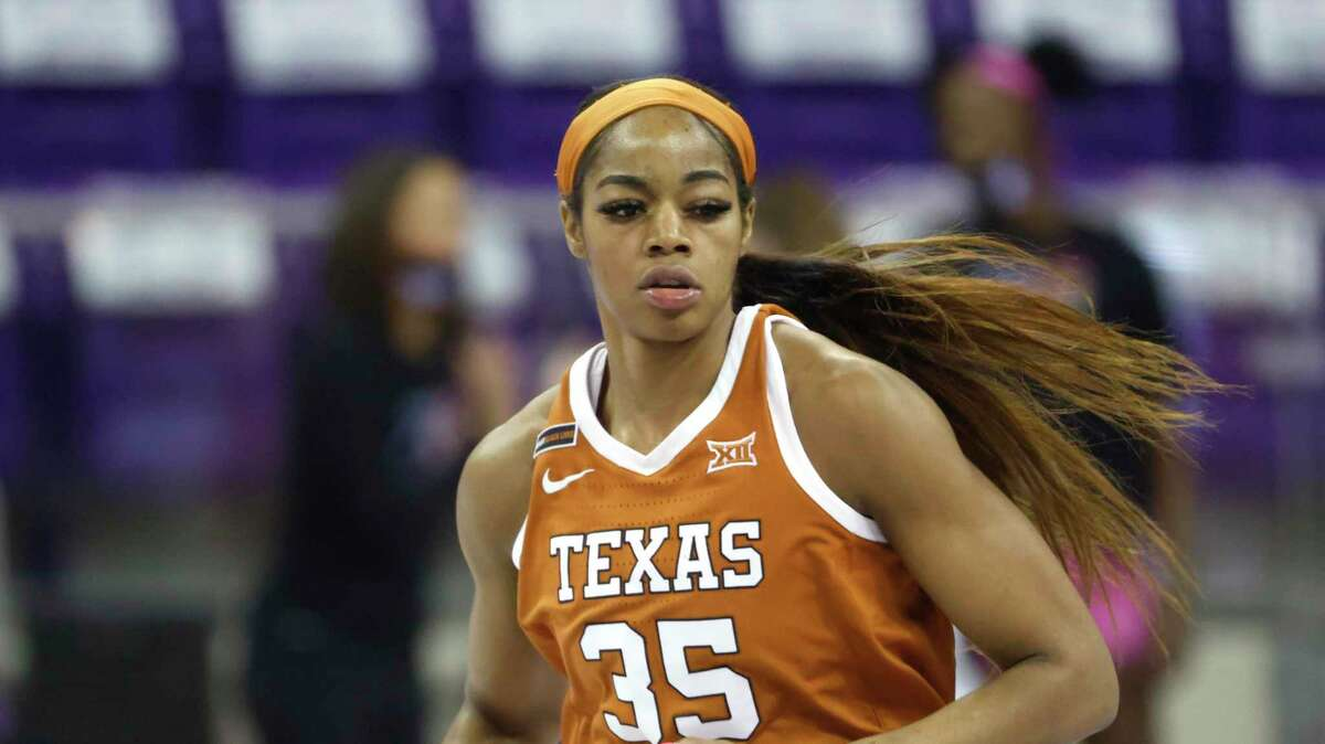 Texas forward Charli Collier (35) runs the court against TCU during the first half of an NCAA college basketball game, Sunday, March 7, 2021, in Fort Worth, Texas. (AP Photo/Ron Jenkins)