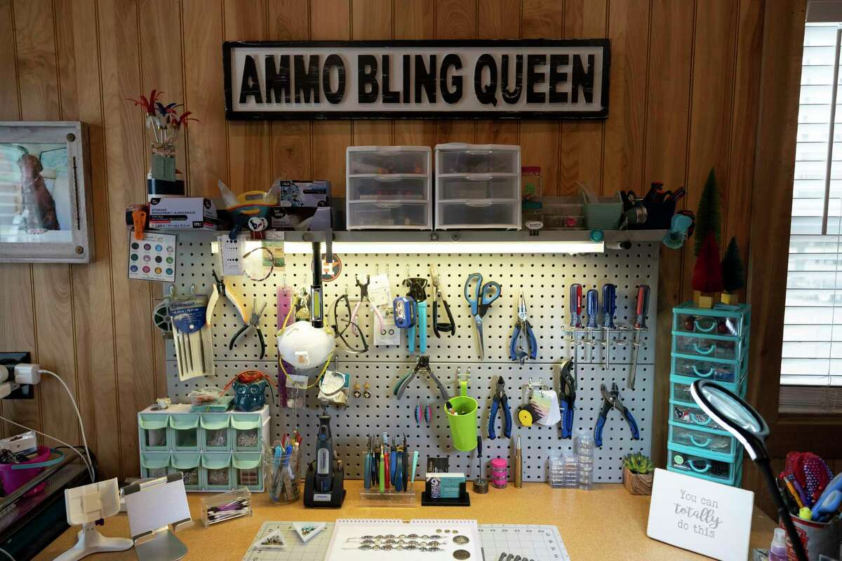 As seen, jewelry is laid out on a work desk for Deborah Baker, owner of Ammo Bling Queen, in her work area, Wednesday, March 10, 2021, in Willis. Baker cuts and finishes all the ammunition that's used in her jewelry.