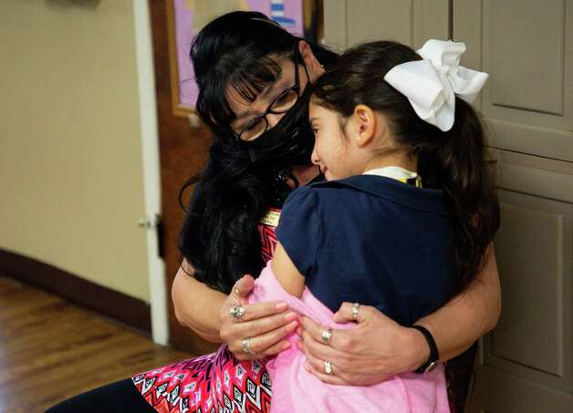 Kindergarten teacher Liz Carrizales, center, is hugged by six-year-old Sophia Martinez inside Creative Corner Child Development Center on Tuesday, March 9, 2021, in Houston. The pandemic has bankrupt daycares across the country, and many have had to consider closing or close all together. Pamela Humphries, who owns Creative Corner, thinks she won't have to close any of her daycares, but says she is worried about her staff's mental health. Photo: Godofredo A. Vásquez, Houston Chronicle / Staff Photographer / © 2021 Houston Chronicle