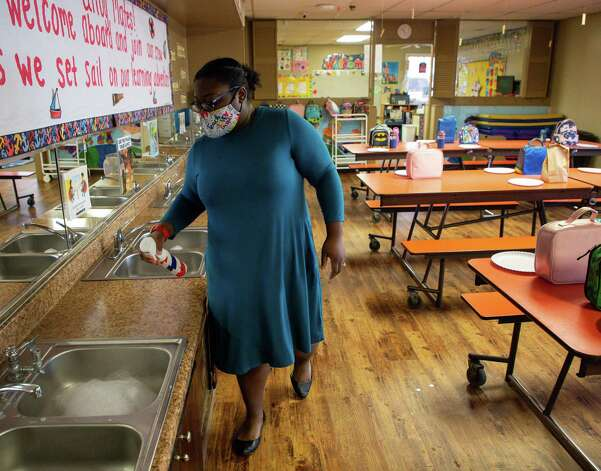 Pre-school teacher Ronisha Hill sanitizes the sink counters after students washed their hands at Creative Corner Child Development Center on Tuesday, March 9, 2021, in Houston. The pandemic has bankrupt daycares across the country, and many have had to consider closing or close all together. Pamela Humphries, who owns Creative Corner, thinks she won't have to close any of her daycares, but says she is worried about her staff's mental health. Photo: Godofredo A. Vásquez, Houston Chronicle / Staff Photographer / © 2021 Houston Chronicle