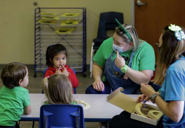 Susana Sanchez, center, talks to Arya Farrera-Andreu, left, in a pre-kindergarten class at Spanish Schoolhouse Preschool on Wednesday, March 10, 2021, in Kingwood, Texas. Kristina Franco, owner of the Spanish Schoolhouse in Kingwood, Tx., says she may have to close down in the next few months if things don't pick back up. She has spent her life savings on her daycare business, and says she has not raised tuition for her students this entire time. Photo: Godofredo A. Vásquez, Houston Chronicle / Staff Photographer / © 2021 Houston Chronicle