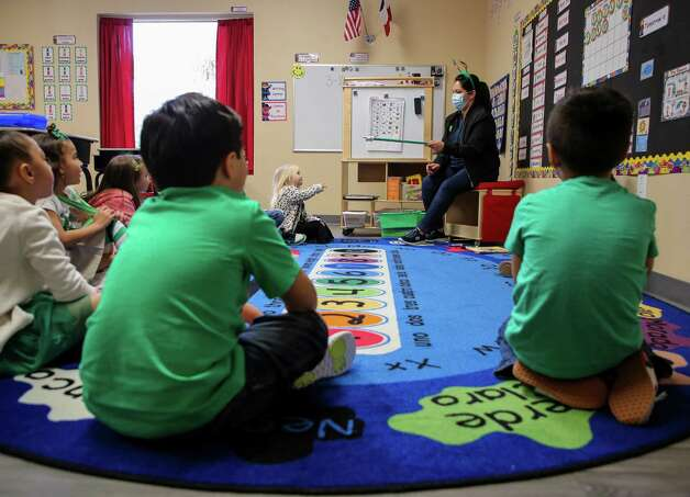 Perla Elizondo, left, talks to her kindergarten class at Spanish Schoolhouse Preschool on Wednesday, March 10, 2021, in Kingwood, Texas. Kristina Franco, owner of the Spanish Schoolhouse in Kingwood, Tx., says she may have to close down in the next few months if things don't pick back up. She has spent her life savings on her daycare business, and says she has not raised tuition for her students this entire time. Photo: Godofredo A. Vásquez, Houston Chronicle / Staff Photographer / © 2021 Houston Chronicle