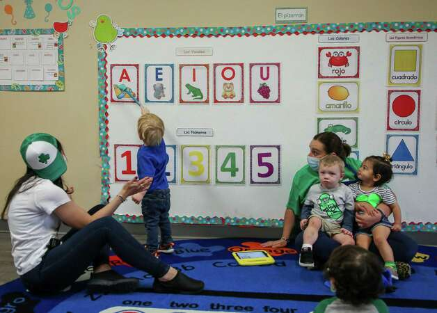 """Teachers Miribeth Mendez, left, and Jannie Rivera, right, watch as one of their students points to the letter """"a""""- per their request in Spanish - at Spanish Schoolhouse Preschool on Wednesday, March 10, 2021, in Kingwood, Texas. Kristina Franco, owner of the Spanish Schoolhouse in Kingwood, Tx., says she may have to close down in the next few months if things don't pick back up. She has spent her life savings on her daycare business, and says she has not raised tuition for her students this entire time. Photo: Godofredo A. Vásquez, Houston Chronicle / Staff Photographer / © 2021 Houston Chronicle"""