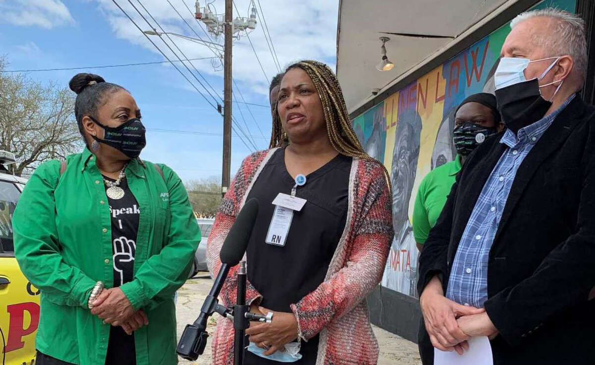 Monica Winn (center), a registered nurse, speaks at a press conference Friday in Houston about a lawsuit she filed against the Freedom Boat Club of Galveston. She alleges the boat club manager harassed her and her guests and used racist language.