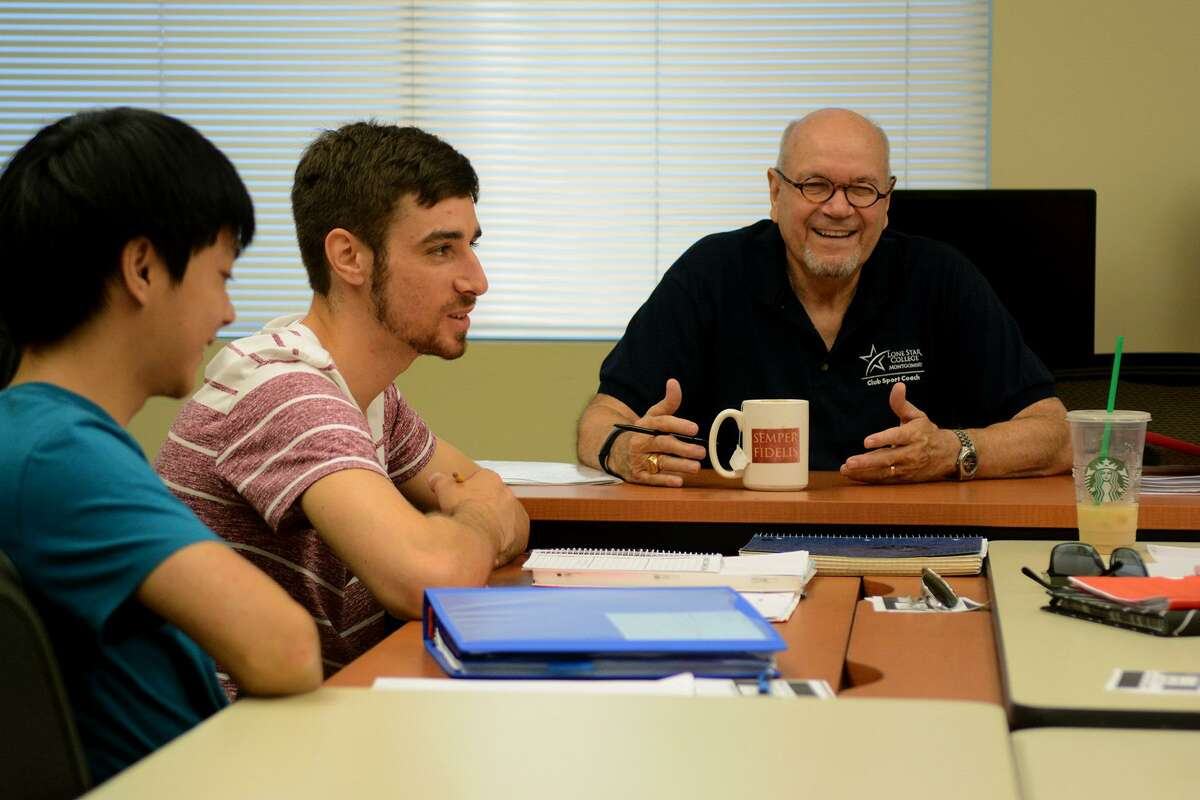 Professor David Parsons, from right, leads his students, including Josh Sandros, 23, of Spring, a family friend of a veteran, and Vuong Nguyen, 20, the son of a veteran, in a group discussion during their creative writing class for veterans and family members at Lone Star College - Montgomery on Sept. 15, 2015. The college will offer scholarships for veterans to take creative writing classes in the fall.
