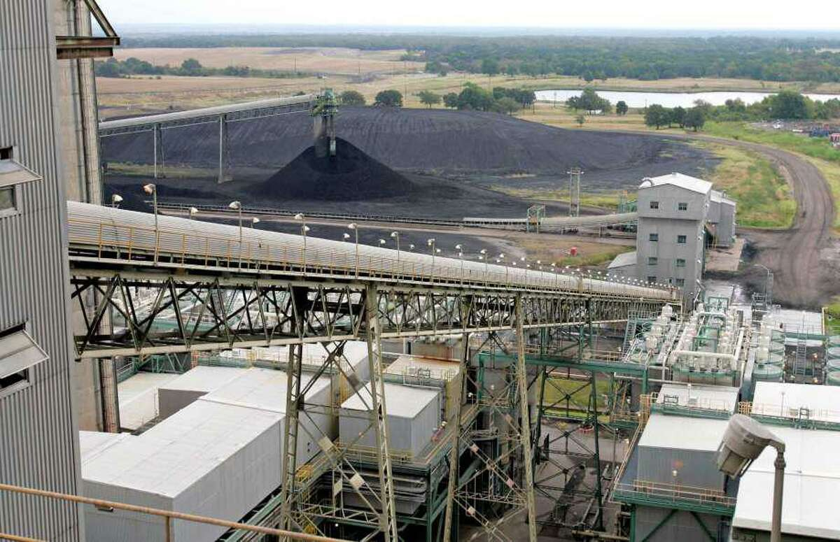 Coal is transported up a conveyor belt into a coal-fired power plant.