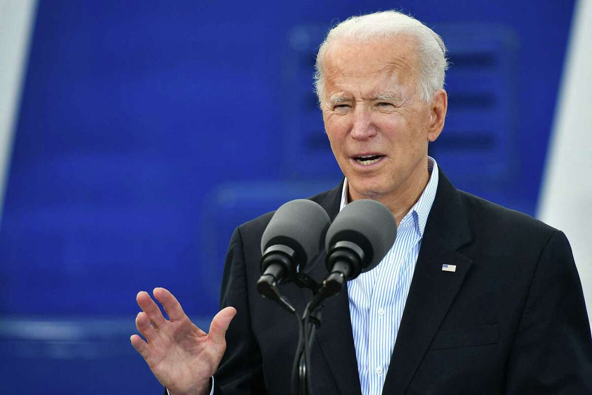 US President Joe Biden speaks after visiting a FEMA Covid-19 vaccination facility at NRG Stadium in Houston, Texas on February 26, 2021. (Photo by MANDEL NGAN / AFP) (Photo by MANDEL NGAN/AFP via Getty Images)
