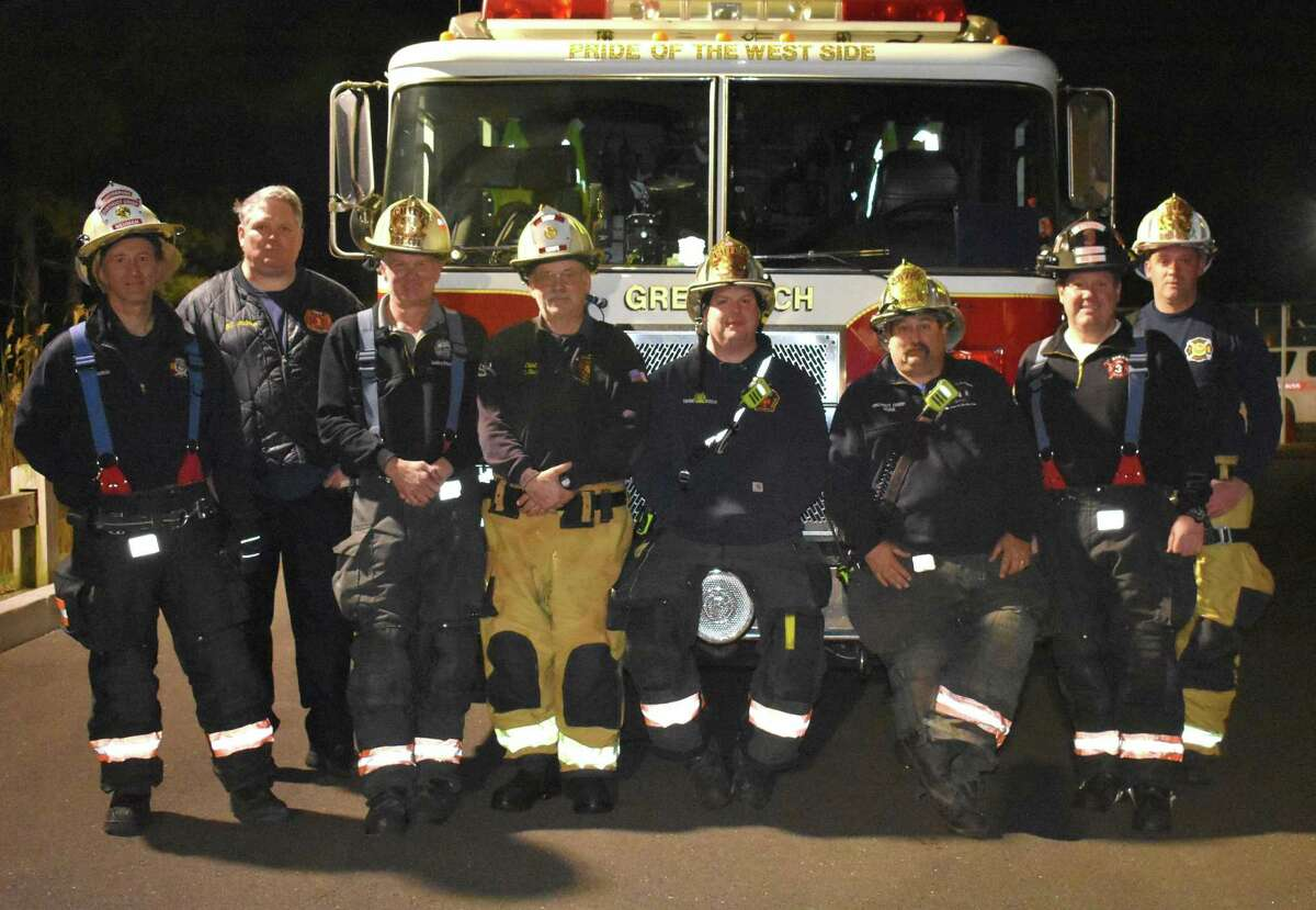 Firefighters from left, Richard Neuman of Station 1, Fire Chief Joe McHugh, Gary Wilson of Station 2, Rick Strain of Station 6, Joe Gianfrancesco of Station 5, Mike Hoha of Station 4, Dave Walko of Station 3, and Al Farquar of Station 7 pose together at the North Street Training Center Thursday, March 11, 2021.