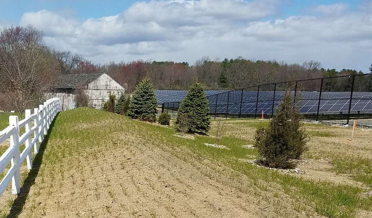 A view of the Tobacco Valley Solar Farm in Simsbury, which went into operation in 2019. The same company that developed this project, D.E. Shaw Renewable Investments, is also behind the Gravel Pit Solar project in East Windsor.