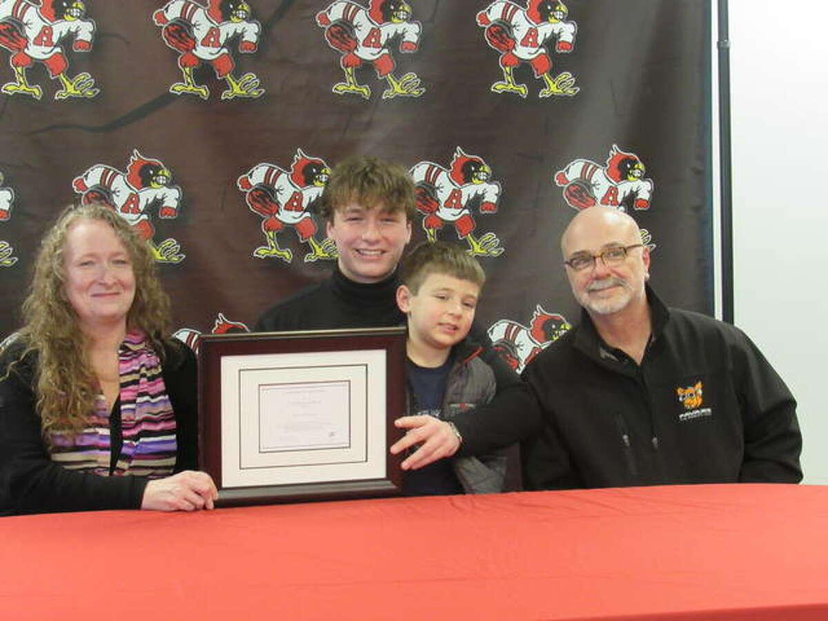 Kieran Favazza, center, was joined by his parents, Patricia Flanagan and Guy Favazza, and his little brother, Theo, at a Friday ceremony recognizing him as a National Merit Scholarship finalist.