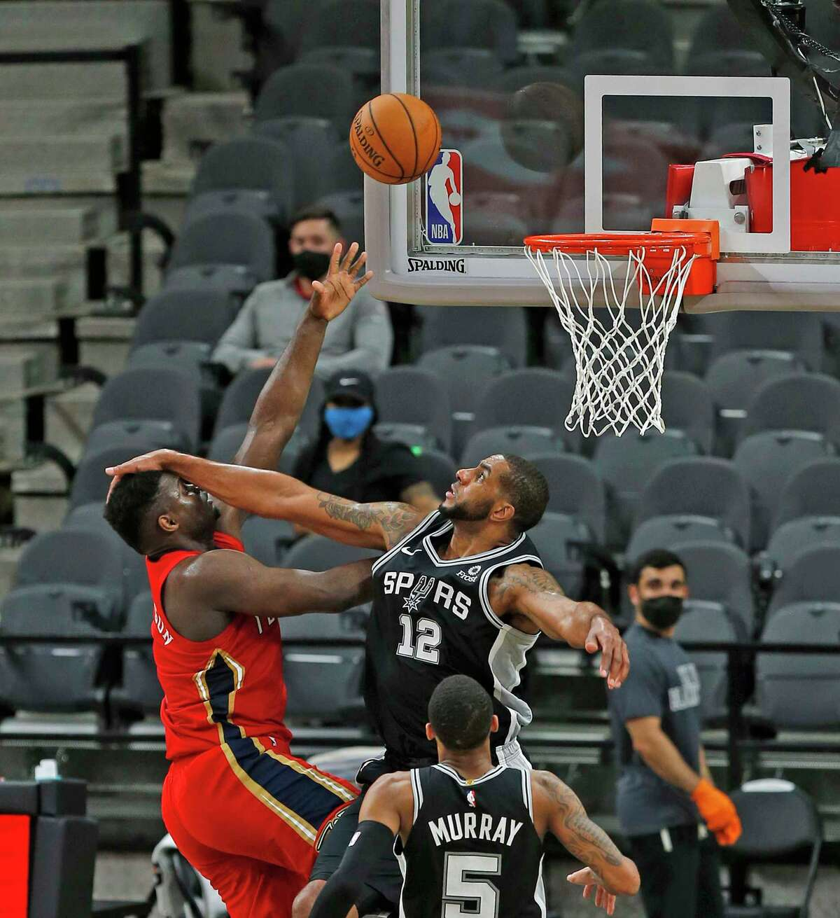 SAN ANTONIO, TX - FEBRUARY 27: LaMarcus Aldridge #12 of the San Antonio Spurs fouls Zion Williamson #1 of the New Orleans Pelicans in the first half at AT&T Center on February 27, 2021 in San Antonio, Texas. NOTE TO USER: User expressly acknowledges and agrees that , by downloading and or using this photograph, User is consenting to the terms and conditions of the Getty Images License Agreement. (Photo by Ronald Cortes/Getty Images)