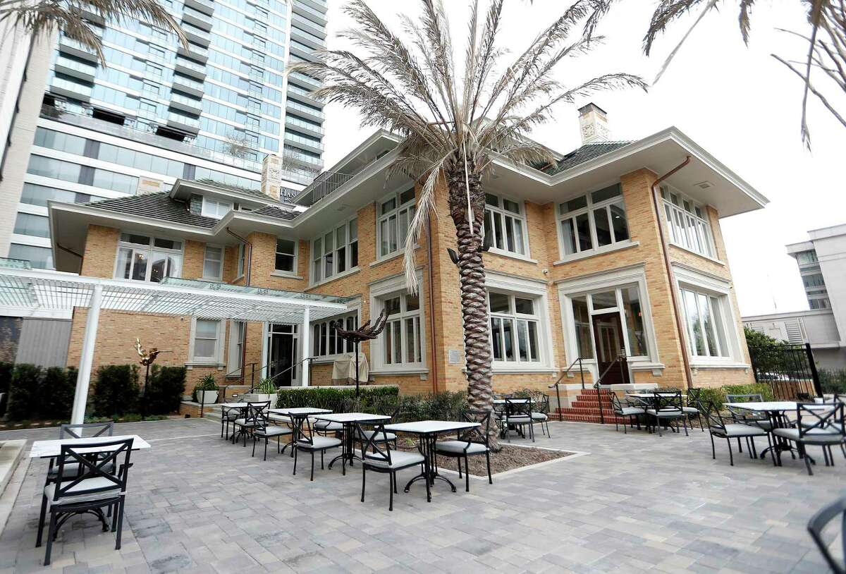 Outdoor patio area outside of La Colombe d'Or Hotel, Thursday, March 11, 2021, in Houston. An expansion of La Colombe d'Or is complete and the renovated historic hotel will reopen in late March. A 34-story apartment tower brings 265 apartment units and 18 luxury hotel rooms with shared amenities including an art gallery and outdoor plaza that connects with the property's original boutique hotel. The Zimmermans partnered with Hines on the development of one acre behind the historic La Colombe d'Or hotel, which has been renovated to the studs in a project that blends old world charm with modern elements. The campus showcases the family's collection of more than 350 art pieces