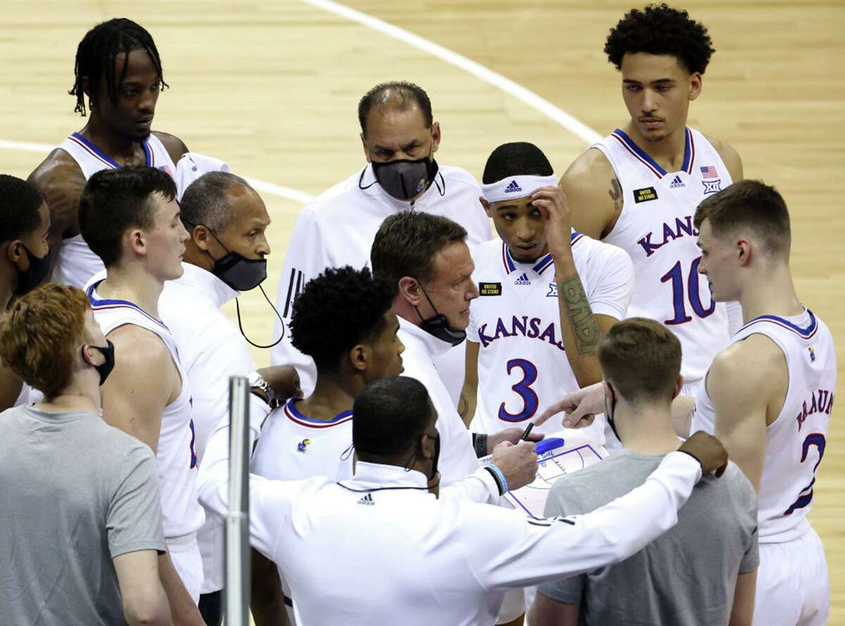 Kansas coach Bill Self, talking to his team during Thursday's game against Oklahoma, said the Jayhawks will continue to prepare for NCAA Tournament after school had to withdraw from Big 12 tournament because of COVID-19 cases.